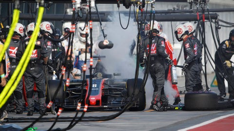 Smoke billows from the car of Haas driver Romain Grosjean in the pits during the Australian Formula One Grand Prix. (Brandon Malone/Pool via AP)