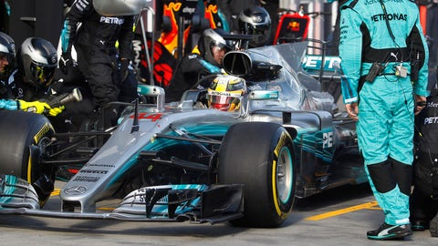 Lewis Hamilton ultimately lost the Australian GP when he came out of the pits and got stuck behind the Ferrari of Sebastian Vettel. (Brandon Malone/Pool Photo via AP)