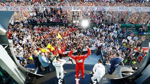 While the crowd always takes to the track to celebrate the F1 podium, usually they are required to hold back until after the cars have returned to the pits. (Photo: Steven Tee/LAT Images)