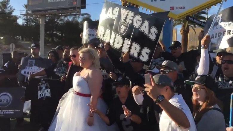 Raiders fan crash couple's wedding underneath the Las Vegas sign