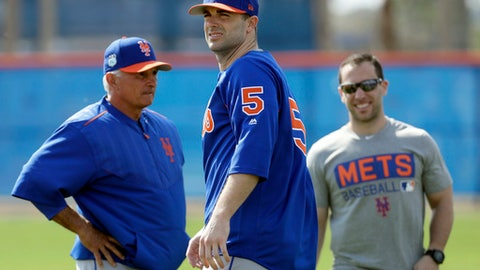 FILE - In this Feb. 15, 2017, file photo, New York Mets third baseman David Wright (5) looks on along with manager Terry Collins, left, during a spring training baseball workout in Port St. Lucie, Fla. Wright has returned from spring training to New York, because of impingement in his right shoulder. The team says the third baseman was examined Tuesday, Feb. 28, 2017, at the Hospital for Special Surgery after feeling discomfort and was told not to throw for two weeks.  (AP Photo/David J. Phillip, File)