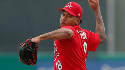 St. Louis Cardinals starting pitcher Carlos Martinez  works in the first inning of a spring training baseball game against the New York Mets, Wednesday, March 1, 2017, in Jupiter, Fla. (AP Photo/John Bazemore)