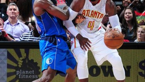 ATLANTA, GA - MARCH 1: Paul Millsap #4 of the Atlanta Hawks posts up against the Dallas Mavericks on March 1, 2017 at Philips Arena in Atlanta, Georgia.  NOTE TO USER: User expressly acknowledges and agrees that, by downloading and/or using this Photograph, user is consenting to the terms and conditions of the Getty Images License Agreement. Mandatory Copyright Notice: Copyright 2017 NBAE (Photo by Scott Cunningham/NBAE via Getty Images)