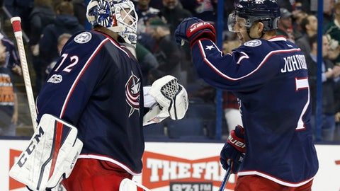 Columbus Blue Jackets' Sergei Bobrovsky, left, of Russia, celebrates with Jack Johnson after the team's 1-0 win over the Minnesota Wild in an NHL hockey game Thursday, March 2, 2017, in Columbus, Ohio. (AP Photo/Jay LaPrete)