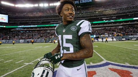 FILE - In this Nov. 27, 2016, file photo, New York Jets wide receiver Brandon Marshall walks off the field after the team's NFL football game against the New England Patriots in East Rutherford, N.J. A person with direct knowledge of the team's decision says the Jets are releasing Marshall, clearing $7.5 million on the salary cap. Marshall is the latest big-name player to be cut by the Jets, who have also parted ways with Darrelle Revis, Nick Mangold, Nick Folk and Breno Giacomini this offseason. (AP Photo/Julio Cortez, File)