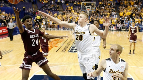 Missouri State's Alize Johnson (24) shoots as Wichita State's Rauno Nurger (20) and Conner Frankamp defend during the second half of an NCAA college basketball game in the semifinals of the Missouri Valley Conference men's tournament, Saturday, March 4, 2017, in St. Louis. Wichita State won 78-63. (AP Photo/Jeff Roberson)