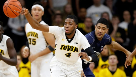 Iowa guard Isaiah Moss (4) grabs the ball ahead of Penn State forward Julian Moore, right, during the second half of an NCAA college basketball game, Sunday, March 5, 2017, in Iowa City, Iowa. (AP Photo/Charlie Neibergall)