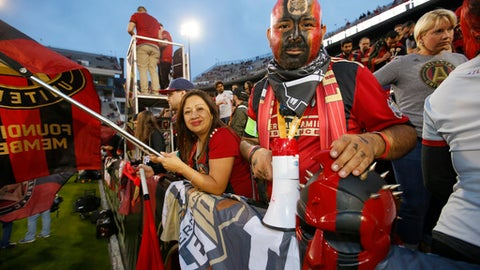 Atlanta United FC fans await an MLS soccer game between the New York Red Bulls and Atlanta United FCon Sunday, March 5, 2017, in Atlanta. (AP Photo/Todd Kirkland)