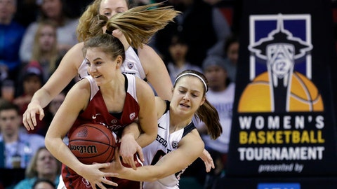 Stanford's Karlie Samuelson, left, and Oregon State's Mikayla Pivec fight for possession of the ball in the first half of the Pac-12 Conference championship NCAA college basketball game, Sunday, March 5, 2017, in Seattle. (AP Photo/Elaine Thompson)