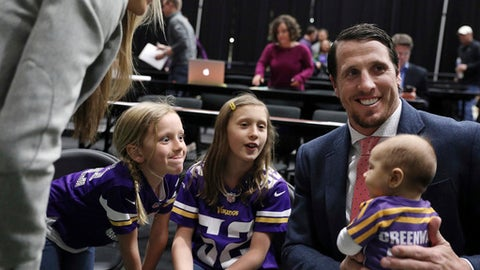 Minnesota Vikings linebacker Chad Greenway holds his youngest daughter, Carsyn, 3-months, as other daughters, Maddy, left, 9, and Beckett, 6, made faces at her following a  press conference where Greenway announced his retirement in Eden Prarie, Minn., Tuesday, March 7, 2017.   (Anthony Souffle/Star Tribune via AP)
