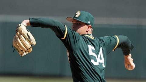 Oakland Athletics' Sonny Gray throws during the first inning of a spring training baseball game against the Arizona Diamondbacks, Tuesday, March 7, 2017, in Scottsdale, Ariz. (AP Photo/Darron Cummings)