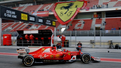 Ferrari driver Sebastian Vettel of Germany leaves the team box during a Formula One pre-season testing session at the Catalunya racetrack in Montmelo, outside Barcelona, Spain, Thursday, March 9, 2017. (AP Photo/Francisco Seco)