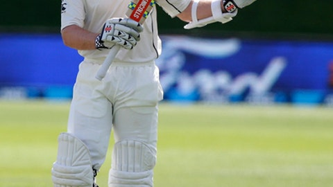 New Zealand's Kane Williamson waves to the crowd after scoring a century against South Africa during the first cricket test at University Oval, Dunedin, New Zealand, Friday, March 10, 2017. (AP Photo/Mark Baker)