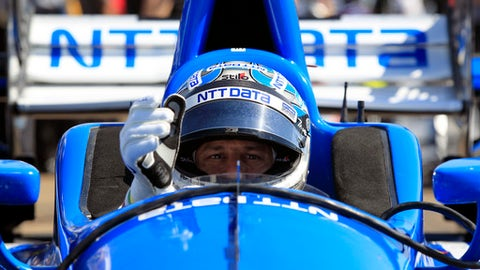 IndyCar driver Tony Kanaan adjusts his gloves before practice for the Grand Prix of St. Petersburg IndyCar race in St. Petersburg, Fla., Friday, March 10, 2017.  (Luis Santana/Tampa Bay Times via AP)