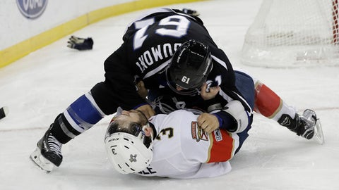 Tampa Bay Lightning center Gabriel Dumont (61) takes down Florida Panthers defenseman Keith Yandle (3) as they fight during the second period of an NHL hockey game Saturday, March 11, 2017, in Tampa, Fla. (AP Photo/Chris O'Meara)