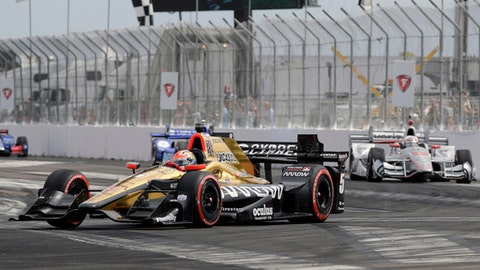 James Hinchcliffe (5), of Canada, leads Will Power (12), of Australia, early in the IndyCar Firestone Grand Prix of St. Petersburg auto race Sunday, March 12, 2017, in St. Petersburg, Fla. (AP Photo/Terry Renna)