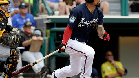 Atlanta Braves' Jace Peterson hits an RBI single in the third inning of a spring training baseball game against the Pittsburgh Pirates, Monday, March 13, 2017, in Kissimmee, Fla. (AP Photo/John Raoux)