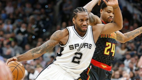 SAN ANTONIO,TX - MARCH 13:  Kawhi Leonard #2 of the San Antonio Spurs drives on Kent Bazemore #24 of the Atlanta Hawks at AT&T Center on March 13, 2017 in San Antonio, Texas.  NOTE TO USER: User expressly acknowledges and agrees that , by downloading and or using this photograph, User is consenting to the terms and conditions of the Getty Images License Agreement. (Photo by Ronald Cortes/Getty Images)