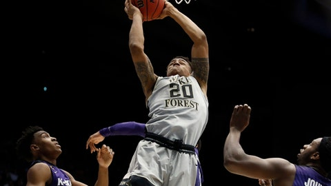 Wake Forest's John Collins (20) shoots against Kansas State's Wesley Iwundu, left, and D.J. Johnson, right, in the first half of a First Four game of the NCAA college basketball tournament, Tuesday, March 14, 2017, in Dayton, Ohio. (AP Photo/John Minchillo)