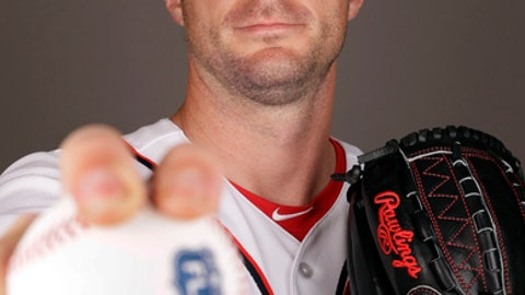 FILE - In this Feb. 23, 2017, file photo, Washington Nationals' Max Scherzer poses for a photograph before a spring training baseball workout in West Palm Beach, Fla. The NL Cy Young Award winner will miss the Nationals' opener against Miami on April 3 because of a stress fracture in his right ring finger. The stress fracture caused Scherzer to change the grip on his fastball, placing three fingers on top of the ball instead of two.  (AP Photo/David J. Phillip, File)