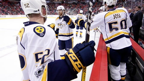 Nashville Predators right wing James Neal, center, celebrates his goal with his teammates in the second period of an NHL hockey game against the Washington Capitals, Thursday, March 16, 2017, in Washington. (AP Photo/Alex Brandon)