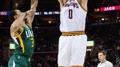 CLEVELAND, OH - MARCH 16: Kevin Love #0 of the Cleveland Cavaliers shoots over George Hill #3 of the Utah Jazz during the first half at Quicken Loans Arena on March 16, 2017 in Cleveland, Ohio. NOTE TO USER: User expressly acknowledges and agrees that, by downloading and/or using this photograph, user is consenting to the terms and conditions of the Getty Images License Agreement. (Photo by Jason Miller/Getty Images)