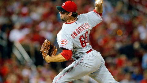 In this Aug. 20, 2014 file photo, Cincinnati Reds relief pitcher Logan Ondrusek throws during the sixth inning of a baseball game against the St. Louis Cardinals, in St. Louis. Ondrusek, due to have his elbow examined next week by Dr. James Andrews, has been released by the Baltimore Orioles. Ondrusek's locker at Baltimore's spring training camp was taken over Thursday, March 16, 2017, by pitcher Gabriel Ynoa. (AP Photo/Scott Kane, File)