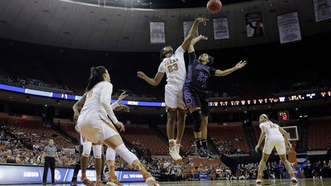 Central Arkansas guard Olivia McWilliams (25) is blocked by Texas guard Ariel Atkins (23) as she tries to score during a first-round game in the NCAA women's college basketball tournament, Friday, March 17, 2017, in Austin, Texas. (AP Photo/Eric Gay)
