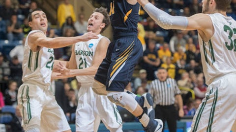 Babson's Charlie Rice (24) and Nick Comenale (21) defend Augustana's Nolan Ebel (14) as he shoots during the first half of the NCAA Division III college basketball championship game Saturday, March 18, 2017, in Salem, Va. (AP Photo/Don Petersen)