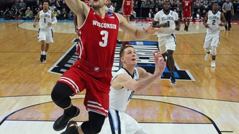 Wisconsin guard Zak Showalter (3) drives to the basket against Villanova guard Donte DiVincenzo (10) during the second half of a second-round game in the NCAA men's college basketball tournament, Saturday, March 18, 2017, in Buffalo, N.Y. Wisconsin won 65-62. (AP Photo/Bill Wippert)