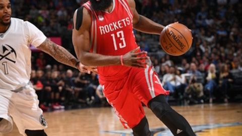 DENVER, CO - MARCH 18:  James Harden #13 of the Houston Rockets handles the ball against the Denver Nuggets on March 18, 2017 at the Pepsi Center in Denver, Colorado. NOTE TO USER: User expressly acknowledges and agrees that, by downloading and/or using this Photograph, user is consenting to the terms and conditions of the Getty Images License Agreement. Mandatory Copyright Notice: Copyright 2017 NBAE  (Photo by Garrett Ellwood/NBAE via Getty Images)