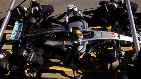 FILE - In this file photo dated Wednesday, March 1, 2017, Mercedes driver Lewis Hamilton of Britain has his tyres changed during a Formula One pre-season testing session at the Catalunya racetrack in Montmelo, outside Barcelona, Spain. Nico Rosberg retired days after becoming world champion but Lewis Hamilton's bid to regain his Formula One title might actually prove harder without him around  (AP Photo/Francisco Seco, FILE)