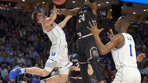 Duke's Grayson Allen, left, is fouled by South Carolina's Sedee Keita, center, as he tries to pass the ball to Harry Giles, right, during the first half in a second-round game of the NCAA men's college basketball tournament in Greenville, S.C., Sunday, March 19, 2017. (AP Photo/Rainier Ehrhardt)