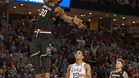 South Carolina's Chris Silva (30) goes up to dunk past Duke's Frank Jackson (15) during the second half in a second-round game of the NCAA men's college basketball tournament in Greenville, S.C., Sunday, March 19, 2017. (AP Photo/Rainier Ehrhardt)