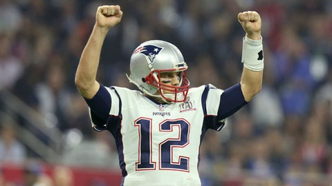 "FILE - In this Feb. 5, 2017, file photo, New England Patriots quarterback Tom Brady celebrates a touchdown against the Atlanta Falcons during Super Bowl 51 in Houston. Tom Brady's missing jersey from the Super Bowl has been found in the possession of a member of the international media. The NFL said in a statement Monday, March 20, 2017 that his jersey was found through the ""cooperation of the NFL and New England Patriots' security teams, the FBI and other law enforcement authorities.""   (AP Photo/Gregory Payan, File)"