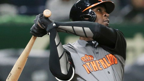 "FILE - In this March 13, 2017, file photo, Netherlands' designated hitter Didi Gregorius hits a three-run home-run off Israel's pitcher Danny Burawa during the fourth inning of their second round game at the World Baseball Classic at Tokyo Dome in Tokyo. New York Yankees shortstop Didi Gregorius has a bruised right shoulder, ending his time at the World Baseball Classic and leaving his status for opening day in doubt. Yankees manager Joe Girardi didn't put on a timetable on a return, only saying, ""He's going to be sidelined for a bit.""(AP Photo/Koji Sasahara, File)"