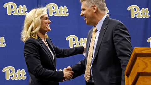 University of Pittsburgh Chancellor Patrick Gallagher, right, introduces Heather Lyke as the scholls new athletic director in Pittsburgh, Monday, March 20, 2017. Lyke was most recently athletic director at Eastern Michigan University. (AP Photo/Gene J. Puskar)