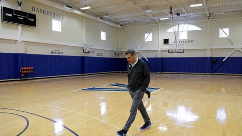 Villanova coach Jay Wright walks to a media availability at the NCAA college basketball team's practice facility, Monday, March 20, 2017, in Villanova, Pa. (AP Photo/Matt Slocum)