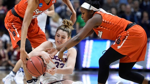 Connecticut's Katie Lou Samuelson, center, is pressured by Syracuse's Briana Day, left, and Alexis Peterson during the first half of a second-round game in the NCAA women's college basketball tournament, Monday, March 20, 2017, in Storrs, Conn. (AP Photo/Jessica Hill)