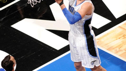 ORLANDO, FL - MARCH 20: Nikola Vucevic #9 of the Orlando Magic  dunks against the Philadelphia 76ers during the game on March 20, 2017 at Amway Center in Orlando, Florida. NOTE TO USER: User expressly acknowledges and agrees that, by downloading and or using this photograph, User is consenting to the terms and conditions of the Getty Images License Agreement. Mandatory Copyright Notice: Copyright 2017 NBAE (Photo by Fernando Medina/NBAE via Getty Images)