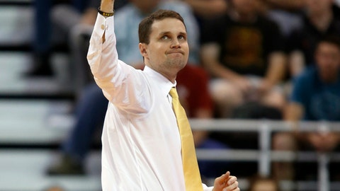 FILE - In this March 16, 2017, file photo, VCU coach Will Wade gestures as he looks at the scoreboard during the first half against Saint Mary's in the first round of the NCAA men's college basketball tournament in Salt Lake City. Wade is leaving VCU to take over LSU after guiding the Rams to the NCAA Tournament in both his seasons as coach. Vice chancellor and athletic director Joe Alleva made the announcement Monday night, March 20, 2017, on LSU's athletics website and Twitter.(AP Photo/George Frey, File)