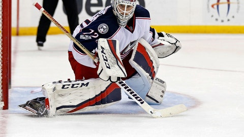 FILE - In this Sunday, March 19, 2017, file photo, Columbus Blue Jackets goalie Sergei Bobrovsky (72) watches the puck after making a save against the New Jersey Devils during the second period of an NHL hockey game in Newark, N.J. The NHL's divisional playoff format is drawing criticism because two of the top three teams in the league could meet in the first round. The Metropolitan Division's Capitals, Penguins, Blue Jackets and Rangers all have more points than any team in the Atlantic, yet one of them is guaranteed to be eliminated early. (AP Photo/Adam Hunger, File)