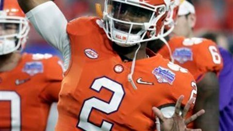 In this Saturday, Dec. 31, 2016, photo, Clemson quarterback Kelly Bryant (2) warms up during the Fiesta Bowl NCAA college football game against Ohio State in Glendale, Ariz. The only downside about having a player such as Deshaun Watson is that it can be hard to convince an elite recruit to come sit behind him for a year or two. That leaves the Tigers with no clear replacement. The holdovers are promising, but not Watson-level talents. (AP Photo/Rick Scuteri)