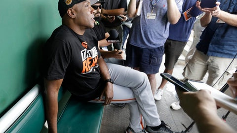 Barry Bonds responds to a question during a news conference Wednesday, March 22, 2017, in Scottsdale, Ariz. Bonds has joined the San Francisco Giants front office as a special adviser. (AP Photo/Darron Cummings)