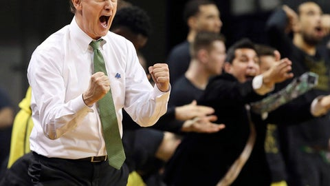 FILE- In this Feb. 4, 2017, file photo, Oregon head coach Dana Altman yells to his team during the second half an NCAA college basketball game against Arizona in Eugene, Ore. The Ducks are through to the Sweet 16 for the second straight season. (AP Photo/Chris Pietsch, File)