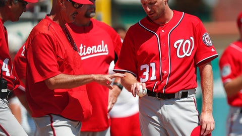 Washington Nationals starting pitcher Max Scherzer (31) works with pitching coach Mike Maddux before a spring training baseball game against the St. Louis Cardinals, Wednesday, March 22, 2017, in Jupiter, Fla. (AP Photo/John Bazemore)