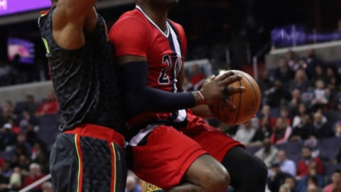 WASHINGTON, DC - MARCH 22:  John Wall #2 of the Washington Wizards puts up a shot in front of Dwight Howard #8 of the Atlanta Hawks  during the first half at Verizon Center on March 22, 2017 in Washington, DC.  NOTE TO USER: User expressly acknowledges and agrees that, by downloading and or using this photograph, User is consenting to the terms and conditions of the Getty Images License Agreement.  (Photo by Rob Carr/Getty Images)