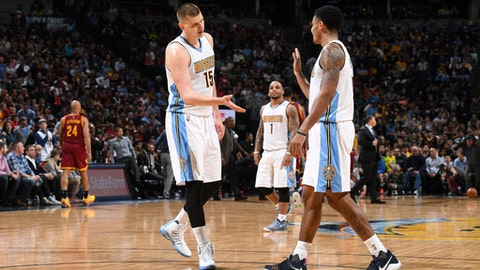 DENVER, CO - MARCH 22: Nikola Jokic #15 and Jamal Murray #27 of the Denver Nuggets high five each other during the game against the Cleveland Cavaliers on March 22, 2017 at the Pepsi Center in Denver, Colorado. NOTE TO USER: User expressly acknowledges and agrees that, by downloading and/or using this Photograph, user is consenting to the terms and conditions of the Getty Images License Agreement. Mandatory Copyright Notice: Copyright 2017 NBAE (Photo by Garrett Ellwood/NBAE via Getty Images)
