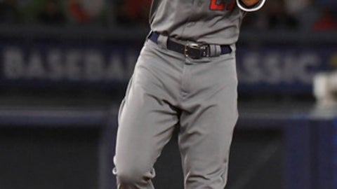 United States' Giancarlo Stanton celebrates a double against Puerto Rico during the ninth inning of the final of the World Baseball Classic in Los Angeles, Wednesday, March 22, 2017. (AP Photo/Mark J. Terrill)