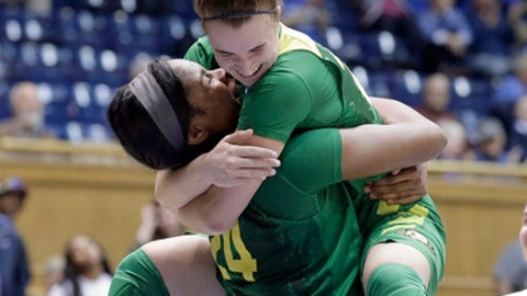 FILE - In this March 18, 2017, file photo, Oregon's Sabrina Ionescu, right, jumps into the arms of teammate Ruthy Hebard following Hebard's late shot to put Oregon ahead in the second half of a first-round game against Temple in the NCAA women's college basketball tournament in Durham, N.C. Back before the start of Pac-12 Conference play, freshman Hebard made the bold prediction that the Ducks would surprise the league--turns out, they've surprised the nation. (AP Photo/Gerry Broome, File)